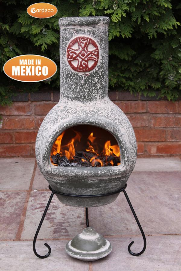 - Large Mexican Chimenea Cruz in green with red motive including stand and lid